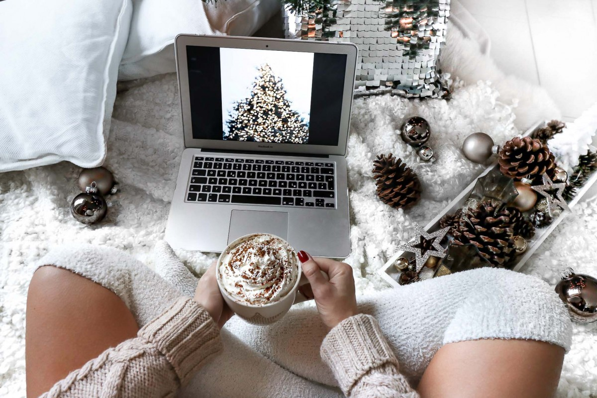 watching a christmas movie, sipping a hot chocolate